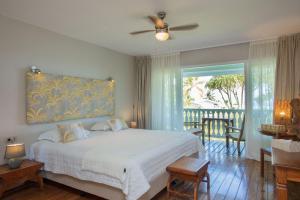 Cama ou camas em um quarto em Hôtel Raiatea Lodge