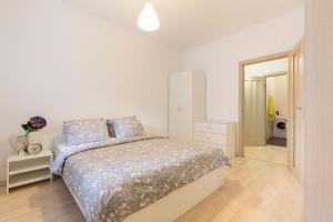 Кровать или кровати в номере White Nights, 42m²
