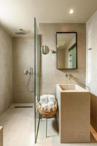 A bathroom at DOM Boutique Hotel