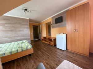 Кровать или кровати в номере Rich Guest House