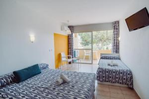 Cama o camas de una habitación en Alper Apartments Mallorca