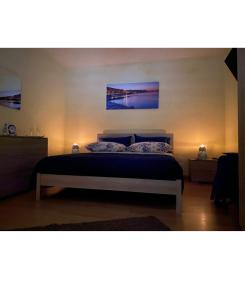 A bed or beds in a room at LisaApartmentHouseSalerno