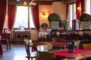 Restaurant ou autre lieu de restauration dans l'établissement Hôtel de charme la Poste