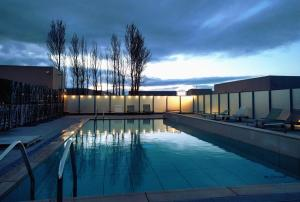 The swimming pool at or near Hotel Aire de Bardenas