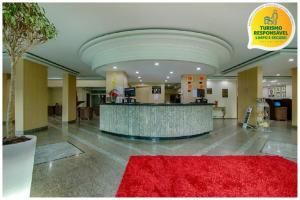 The lobby or reception area at Golden Park Curitiba