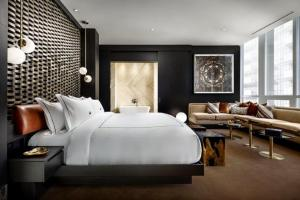 A bed or beds in a room at Bisha Hotel Toronto