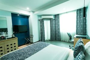 A television and/or entertainment center at Bay Area Suites Manila - Quarantine Hotel
