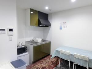 A kitchen or kitchenette at A&C STAY 十三Ⅲ -アベニール十三