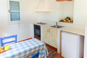 A kitchen or kitchenette at Cyprus Villages Agrotourism
