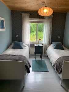 En eller flere senger på et rom på Nordbø Pensjonat