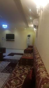 Uma área de estar em استراحة الرونق Al Rownaq chalet