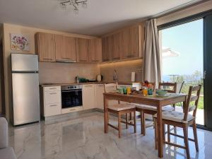 A kitchen or kitchenette at Freesia Grand Sea View Apartment
