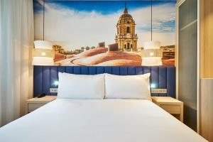 Säng eller sängar i ett rum på Eurostars Astoria