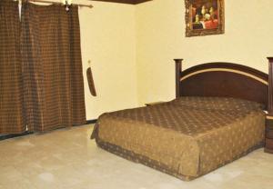 Cama ou camas em um quarto em Golden Prince Hotel Al Rabwah