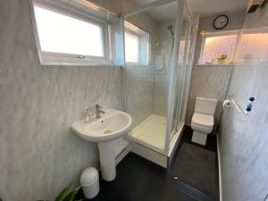 A bathroom at BEST ROOM