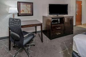 A television and/or entertainment center at La Quinta by Wyndham Dallas I-35 Walnut Hill Ln