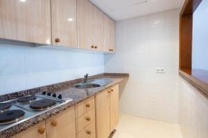 Cuisine ou kitchenette dans l'établissement Mallorca Rooms Peguera