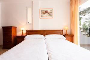 Un ou plusieurs lits dans un hébergement de l'établissement Mallorca Rooms Peguera