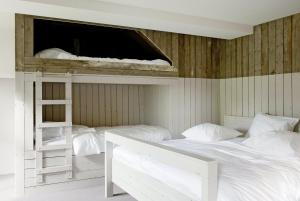 A bed or beds in a room at Teaching Hotel
