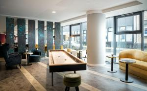 A billiards table at ANA Living Oberhausen by Arthotel ANA