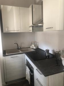 Küche/Küchenzeile in der Unterkunft Abbazia Apartaments