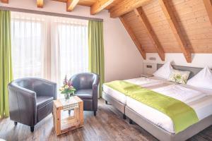 A bed or beds in a room at Adler Landhotel