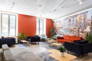 The lobby or reception area at B&B Hotel Roma Tuscolana San Giovanni