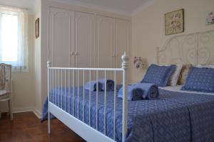 Cama ou camas em um quarto em Petunia - Guest House