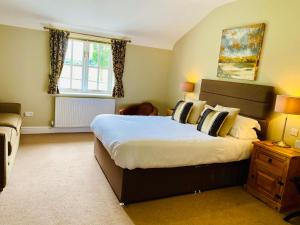 A bed or beds in a room at New Farm