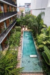 A view of the pool at Hotel Villa Amazônia or nearby