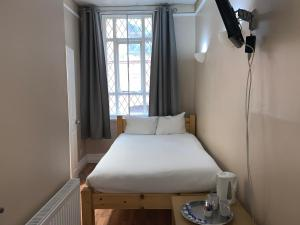 A bed or beds in a room at New Union