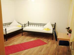 Ein Bett oder Betten in einem Zimmer der Unterkunft Apartments Nürnberg