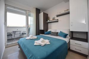 Posteľ alebo postele v izbe v ubytovaní Pool Apartments & Rooms Mare