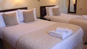 A bed or beds in a room at Weston Hall Hotel Sure Hotel Collection by Best Western