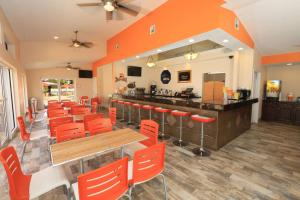 A restaurant or other place to eat at SureStay Plus by Best Western Orlando International Drive