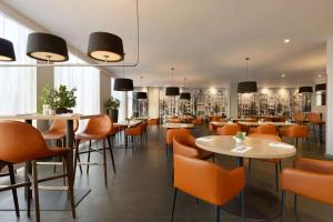 A restaurant or other place to eat at Ramada by Wyndham Amsterdam Airport Schiphol