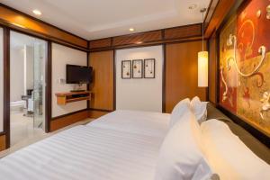 Кровать или кровати в номере Banyan Tree Phuket - SHA Plus