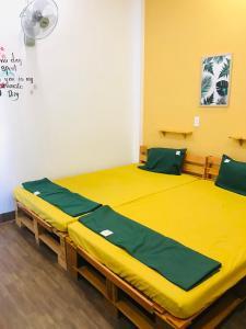 Giường trong phòng chung tại XAM HOUSE HOSTEL