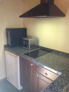 Una cocina o zona de cocina en Apartamentos Rurales A Fala