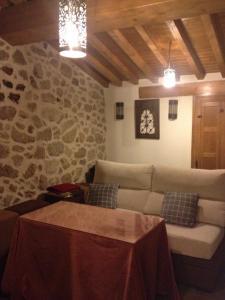 Cama o camas de una habitación en Apartamentos Rurales A Fala