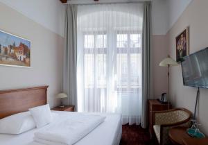 Postel nebo postele na pokoji v ubytování Wellness Hotel Ida
