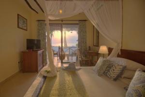 Een zitgedeelte bij Sultan Sands Island Resort