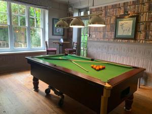 A pool table at Cedars Inn by Greene King Inns