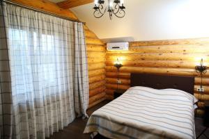 Кровать или кровати в номере Гостевой Дом Атриум
