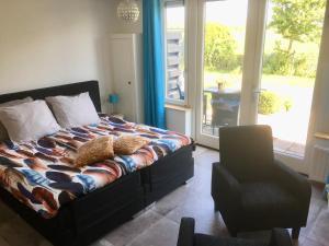 Een bed of bedden in een kamer bij Hofwestdijk