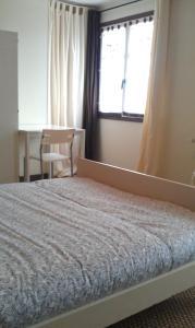 A bed or beds in a room at Gîte à Châtelus, au calme dans l'Allier