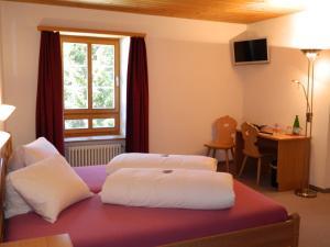 Ein Bett oder Betten in einem Zimmer der Unterkunft Hotel Preda Kulm