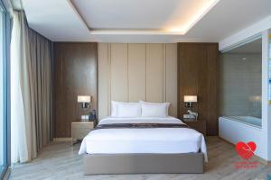 A bed or beds in a room at Panoramic Nha Trang
