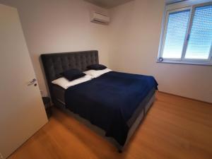 Ein Bett oder Betten in einem Zimmer der Unterkunft Spa Residenz Neusiedl