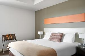 A bed or beds in a room at Dandenong Central Apartments